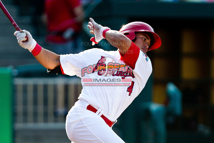 Kolten Wong (4) of the Springfield Cardinals follows through his swing during a game against the Arkansas Travelers at Hammons Field on May 5, 2012 in Springfield, Missouri. (David Welker/Four Seam Images)