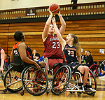 MARSHALL, MN - MARCH 15:  Barbara Gross #23 from Alabama shoots over Erica Wilson #23 from Illinois at the 2018 National Intercollegiate Wheelchair Basketball Tournament at Southwest Minnesota State University in Marshall, MN. (Photo by Dave Eggen/Inertia)