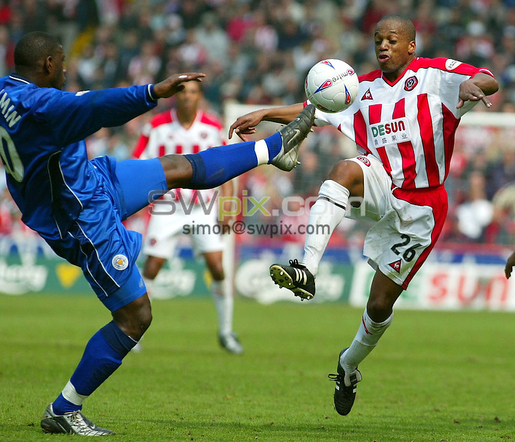 Pix, Shaun Flannery/SWpix. Nationwide League Division One..Sheffield United v Leicester City, 21/4/2003..COPYRIGHT PICTURE>>SIMON WILKINSON>>01943 - 436649>>..Leicester's Trevor Benjamin clears the ball from United's Mark Rankine.