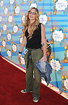 SANTA MONICA, CA. - March 14: Drea De Matteo attends the Make-A-Wish Foundation's Day of Fun hosted by Kevin & Steffiana James held at Santa Monica Pier on March 14, 2010 in Santa Monica, California.