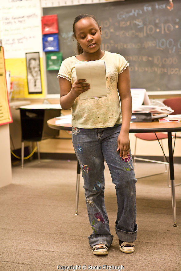 Elementary school students read their own work in Amber Flame's afterschool Spoken Word class.