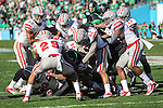North Texas Mean Green running back Brandin Byrd (24) gets smothered by UNLV players during the Heart of Dallas  Bowl game between the North Texas Mean Green and the UNLV Rebels at the Cotton Bowl Stadium in Dallas, Texas. UNT defeats UNLV 36 to 14.