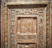 Ancient Egyptian False Door stele of Chamberlain Hornakht, son of Mera, slimestone, Middle Kingdom, 12th Dynasty (1939-1759 BC),  Egyptian Museum, Turin. Old fund cat 1612. <br /> <br /> A false door is an artistic representation of a door which does not function like a real door. They can be carved in a wall or painted on it. They are a common architectural element in the tombs of ancient Egypt,
