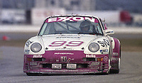 The #99 Porsche 911 Carerra RSR of Andy Pilgrim, Harald Grobs, aLarry Schumacher, and Will Pace races to a 12th place finish in the 24 Hours of Daytona, IMSA race, Daytona International Speedway, Daytona Beach , FL, February 4, 1996.  (Photo by Brian Cleary/www.bcpix.com)