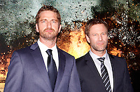 """L'attore scozzese Gerard Butler, sinistra, e lo statunitense Aaron Eckhart all'anteprima del film """"Attacco al potere"""" a Roma, 5 aprile 2013..Actors Gerard Butler, of Britain, left, and  Aaron Eckhartm of the United States, pose at the premiere of the movie """"Olympus has fallen"""" in Rome, 5 April 2013..UPDATE IMAGES PRESS/Riccardo De Luca"""