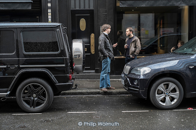 Two men outside a cafe in Wardour St, London, a centre for film and TV production.