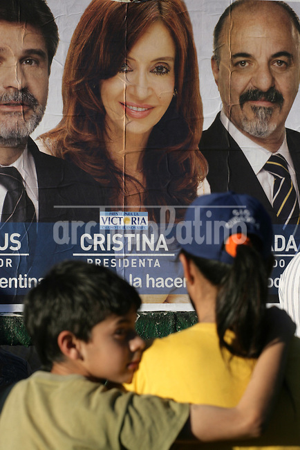 Members of unemployed people organizations stay  near a poster showing the face of Argentina First Lady and presidential candidate Cristina Fernadez de Kirchner during a rally in dowtown Buenos Aires calling not vote in October 28th national election.