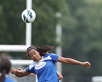 Boston Breakers midfielder Mariah Noguiera (20) battle for head ball.  In a National Women's Soccer League (NWSL) match, Portland Thorns FC (white/black) defeated Boston Breakers (blue), 2-1, at Dilboy Stadium on July 21, 2013.