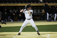 Shane Muntz (11) of the Wake Forest Demon Deacons at bat against the Louisville Cardinals at David F. Couch Ballpark on March 6, 2020 in  Winston-Salem, North Carolina. The Cardinals defeated the Demon Deacons 4-1. (Brian Westerholt/Four Seam Images)