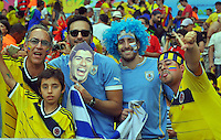 BELO HORIZONTE - BRASIL -28-06-2014. Los hinchas colombianos y uruguayos disfrutan del juego de los octavos de final en el estadio Maracaná de Rio de Janeiro entre Colombia (COL) y Uruguay (URU), hoy 29 de junio de 2014, por la Copa Mundial de la FIFA Brasil 2014./ Fans of Colombia and Uruguay enjoy the match of the Round of 16 at Maracana stadium in Rio do Janeiro between Colombia (COL) and Grece(GRC), today June 28 2014 for the 2014 FIFA World Cup Brazil. Photo: VizzorImage / Alfredo Gutiérrez / Contribuidor