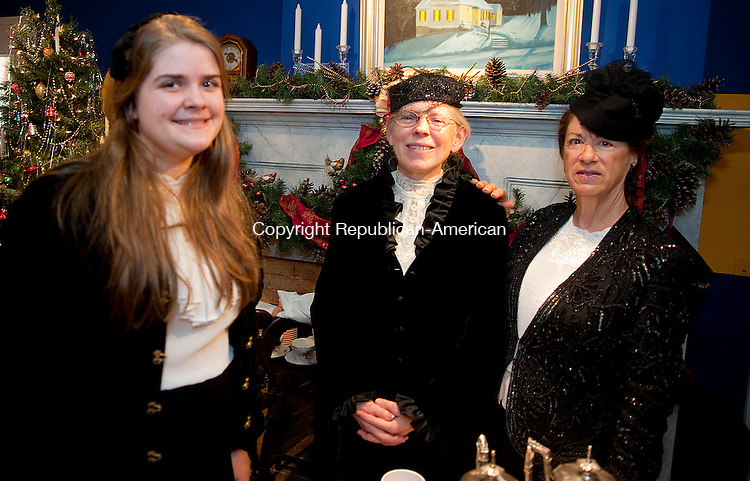 WASHINGTON, CT-010414JS20- Museum volunteers Maddy Martin of Roxbury; Ann Quackenbos of Washington and Sandy Booth of Bethlehem at  a Victorian Tea Party celebrating the new year at the Gunn Historical Museum in Washington. <br />  Jim Shannon Republican-American