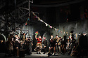 """London, UK. 09.03.2016. English Touring Opera presents """"Don Giovanni"""", by Wolfgang Amadeus Mozart, at the Hackney Empire.  Directed by Lloyd Wood, with set & costume design by Anna Fleischle and lighting design by Guy Hoare. Picture shows:  Lucy Hall (Zerlina), Bradley Travis (Masetto) and the chorus.. Photograph © Jane Hobson."""