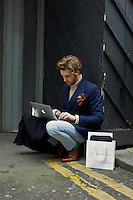 Dan Kennedy working during Fashion Week