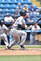 Charleston RiverDogs second baseman Kyle Holder (4) swings at a pitch during a game against the Asheville Tourists at McCormick Field on July 10, 2016 in Asheville, North Carolina. The Tourists defeated the RiverDogs 4-2. (Tony Farlow/Four Seam Images)