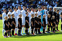 The All Whites sing the national anthem before the 2018 FIFA World Cup Russia first-leg playoff football match between the NZ All Whites and Peru at Westpac Stadium in Wellington, New Zealand on Saturday, 11 November 2017. Photo: Dave Lintott / lintottphoto.co.nz