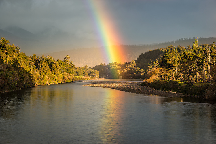Rainbow over Mokihinui River near Karamea, West Coast, South Island, New Zealand - stock photo, canvas, fine art print