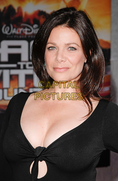 """MEREDITH SALENGER .World premiere of """"Race to Witch Mountain, El Capitan Theatre, Hollywood, California, USA,.March 11th 2009..portrait headshot black cleavage tied cut out boobs .CAP/ROT.©Lee Roth/Roth Stock/Capital Pictures."""