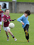 James Smith from Oliver Plunketts tries to block Newtown Blues Tom Cummins at the O'Raghalligh's GAA blitz. Photo: www.pressphotos.ie