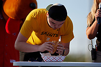 Batavia Muckdogs on field eating contest promotion during a NY-Penn League game against the Auburn Doubledays on June 18, 2019 at Dwyer Stadium in Batavia, New York.  Batavia defeated Auburn 7-5.  (Mike Janes/Four Seam Images)