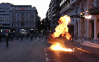 Pictured: A firebomb explodes near riot police Sunday 09 May 2016<br /> Re: Riots break out between protesters and police in Syntagma Square, while MPs in the Greek Parliament vote for new tax, pension and welfare reforms in Athens, Greece