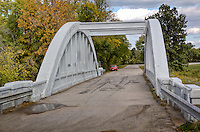 Rainbow Arch Bridge was constructed in 1923 over the Brush Creek.<br /> <br /> West of Riverton on the way to Baxter Springs, Kansas you'll find this historic Marsh Arch &quot;Rainbow Bridge&quot; on the old alignment of Route 66. Through the efforts of the Kansas Historic Route 66 Association this historic bridge was saved and restored in 1992. Not only does this bridge make great photo opportunities, but you can still drive over it!<br /> <br /> It is the only remaining Marsh Rainbow Arch Bridge on Route 66.<br /> It was listed on the National Registry, March 10,1983.