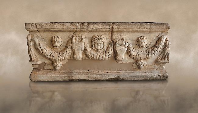 Roman relief garland sculpted sarcophagus. Adana Archaeology Museum, Turkey. Against a warm art background
