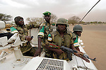 Members of the African Union force on patrol in Labado, in the Darfur region of Sudan, in 2005. The AU force, which was unable to stem the violence, was absorbed in early 2008 into a larger peacekeeping force under the control of the United Nations. The conflict in Darfur has killed some 400,000 people and left 2.5 million displaced since 2003.