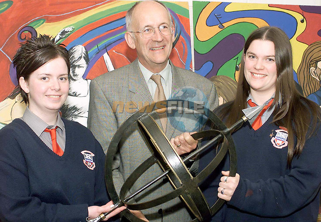 Frank Aiken presents the Aiken award for Senior Cycle Practical subjects to joint winners Orla O'Grady and Neassa Kavanagh at the Ardee Community School annual award ceremony held in the Bohemian Centre, Ardee.