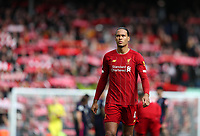 7th March 2020; Anfield, Liverpool, Merseyside, England; English Premier League Football, Liverpool versus AFC Bournemouth; Virgil van Dijk of Liverpool looks on as fans raise their scarves and sing You'll Never Walk Alone prior to the kick off