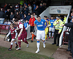 Ross Chisholm and Lee McCulloch lead the teams out at Gayfield