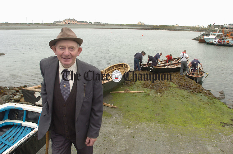 Local man P.J. Magnier gets ready to present the prizes during the Currach races as part of the  Kilbaha Gathering Festival. Photograph by John Kelly.