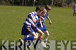 Twos company, threes a crowd! Dingle midfielders Tip Delaney and Donal Kennedy attempt to swarm past beleagured Killarney Athletic full back Robert Mulcahy in their U13 Cup match..