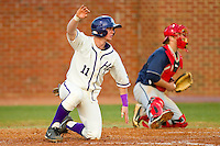 Spencer Angelis (11) of the High Point Panthers slides across home plate to score a run against the Liberty Flames at Willard Stadium on March 23, 2013 in High Point, North Carolina.  The Panthers defeated the Flames 9-3.  (Brian Westerholt/Four Seam Images)