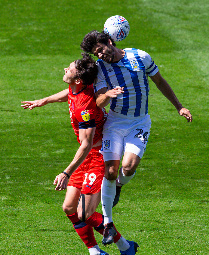 Huddersfield Town's Christopher Schindler battles with Wigan Athletic's Kieffer Moore<br /> <br /> Photographer Alex Dodd/CameraSport<br /> <br /> The EFL Sky Bet Championship - Huddersfield Town v Wigan Athletic - Saturday 20th June 2020 - John Smith's Stadium - Huddersfield <br /> <br /> World Copyright © 2020 CameraSport. All rights reserved. 43 Linden Ave. Countesthorpe. Leicester. England. LE8 5PG - Tel: +44 (0) 116 277 4147 - admin@camerasport.com - www.camerasport.com