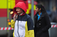 Pictured: A women walks as she battle with the wind and rain in Swansea City Centre, Swansea Wales, UK. Friday 08 February 2019<br /> Re: