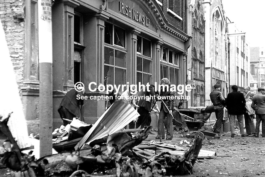 Staff clear debis after explosion at Irish News offices, Upper Donegall Street, Belfast,  N Ireland. Damage was minor and there were no serious injuries.  The attack was blamed on the Provisional IRA who it is believed were unhappy with the newspaper's editorial stance. 17th April 1973. 197304170205b.<br />