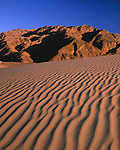 Sand dunes at sunset in Death Valley National Park, California, USA. .  John offers private photo tours throughout the western USA, especially Colorado. Year-round.