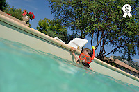 Girl with snorkeling gear in swimming pool (Licence this image exclusively with Getty: http://www.gettyimages.com/detail/85071244 )