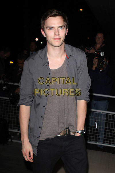 NICHOLAS HOULT .'An Evening At Sanderson' at The Sanderson Hotel, London, England. .April 27th 2010 .half length grey gray top shirt hand in pocket .CAP/AH.©Adam Houghton/Capital Pictures.