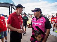 Oct 16, 2016; Ennis, TX, USA; NHRA funny car driver Cruz Pedregon (right) talks to NHRA president Peter Clifford during the Fall Nationals at Texas Motorplex. Mandatory Credit: Mark J. Rebilas-USA TODAY Sports