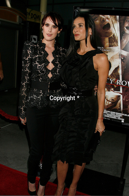 """HOLLYWOOD, CA. - September 03: Rumer Willis and Demi Moore arrive at the Los Angeles premiere of """"Sorority Row"""" at the ArcLight Hollywood theater on September 3, 2009 in Hollywood, California."""