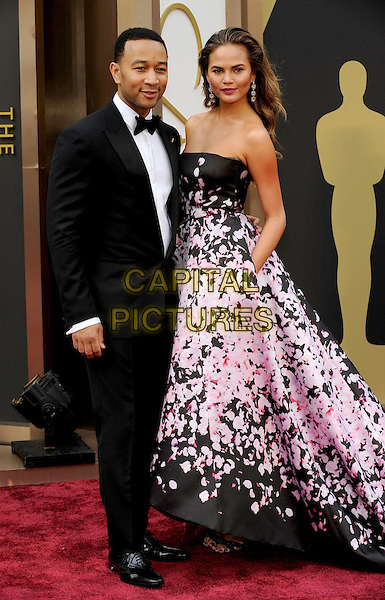 HOLLYWOOD, CA - MARCH 2: John Legend, Christine Teigen arriving to the 2014 Oscars at the Hollywood and Highland Center in Hollywood, California. March 2, 2014.  <br /> CAP/MPI/mpi99<br /> &copy;mpi99/MediaPunch/Capital Pictures