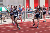 With Latricia Book (#692) clapping her on,  Collegiate School of Medicine and Bioscience sophomore Tiffany Lomax anchors her team to a runner-up finish in the Class 2 4x100 in 51.20 at the Missouri Class 1 and 2 State Track and Field Championships in Jefferson City, Saturday, May 21.