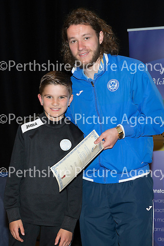 St Johnstone FC Youth Academy Presentation Night at Perth Concert Hall..21.04.14<br /> Stevie May presents to Elliott Scott<br /> Picture by Graeme Hart.<br /> Copyright Perthshire Picture Agency<br /> Tel: 01738 623350  Mobile: 07990 594431