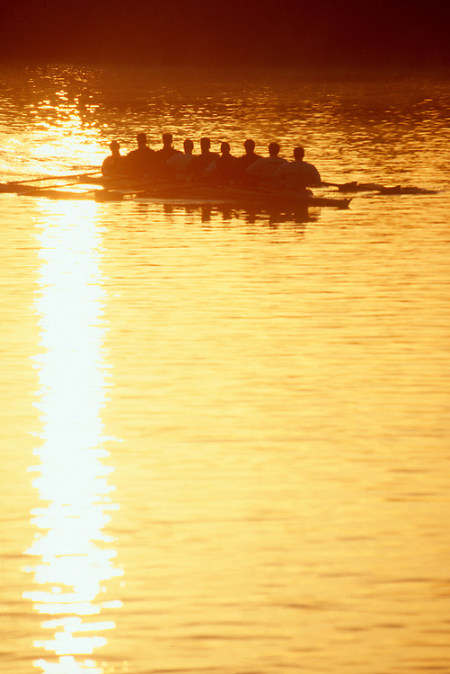 Rowing, men's eight oared racing shell in sunrise silhouette, Seattle,