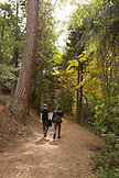 USA, Oregon, Ashland, friends take a walk in the park along the Lithia River in Lithia Park