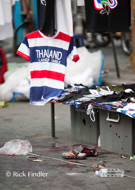 23.02.14 The scene where a young boy was killed and 24 others were injured today at a bomb blast site in the heart of Bangkok, Thailand. Three children suffered serious head injuries from the blast as tensions between anti-government supporters and pro-government supporters rise.
