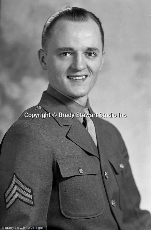 Wilkinsburg PA:  Sargent Brady Stewart Jr. posing for a portrait while on leave in Pittsburgh - 1944.  Brady Stewart Jr. was a staff photographer at fort