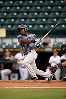 Tampa Yankees left fielder Tito Polo (18) follows through on a swing during the second game of a doubleheader against the Bradenton Marauders on June 14, 2017 at LECOM Park in Bradenton, Florida.  Tampa defeated Bradenton 5-1.  (Mike Janes/Four Seam Images)