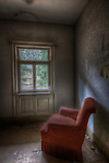 An old hotel in the Black Forest with red easy chair